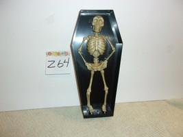 Halloween Dancing Lighted Musical Skeleton Coffin - $468,40 MXN