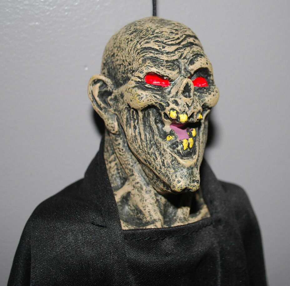 "Primary image for Scary Ghoul Monster Red Eyes & Teeth Hanging Halloween Decoration 15"" T Plastic"