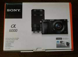 Sony Alpha a6000 Mirrorless Camera w/ 16-50mm and 55-210mm Power Zoom Le... - $530.00
