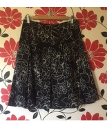 Smart Set Black Pleaded Skirt with White Floral Print, size 5 - $8.00