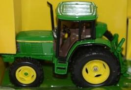 John Deere TBE15489 Die Cast Metal Replica 1999 6410 Tractor Wagon Disk image 2