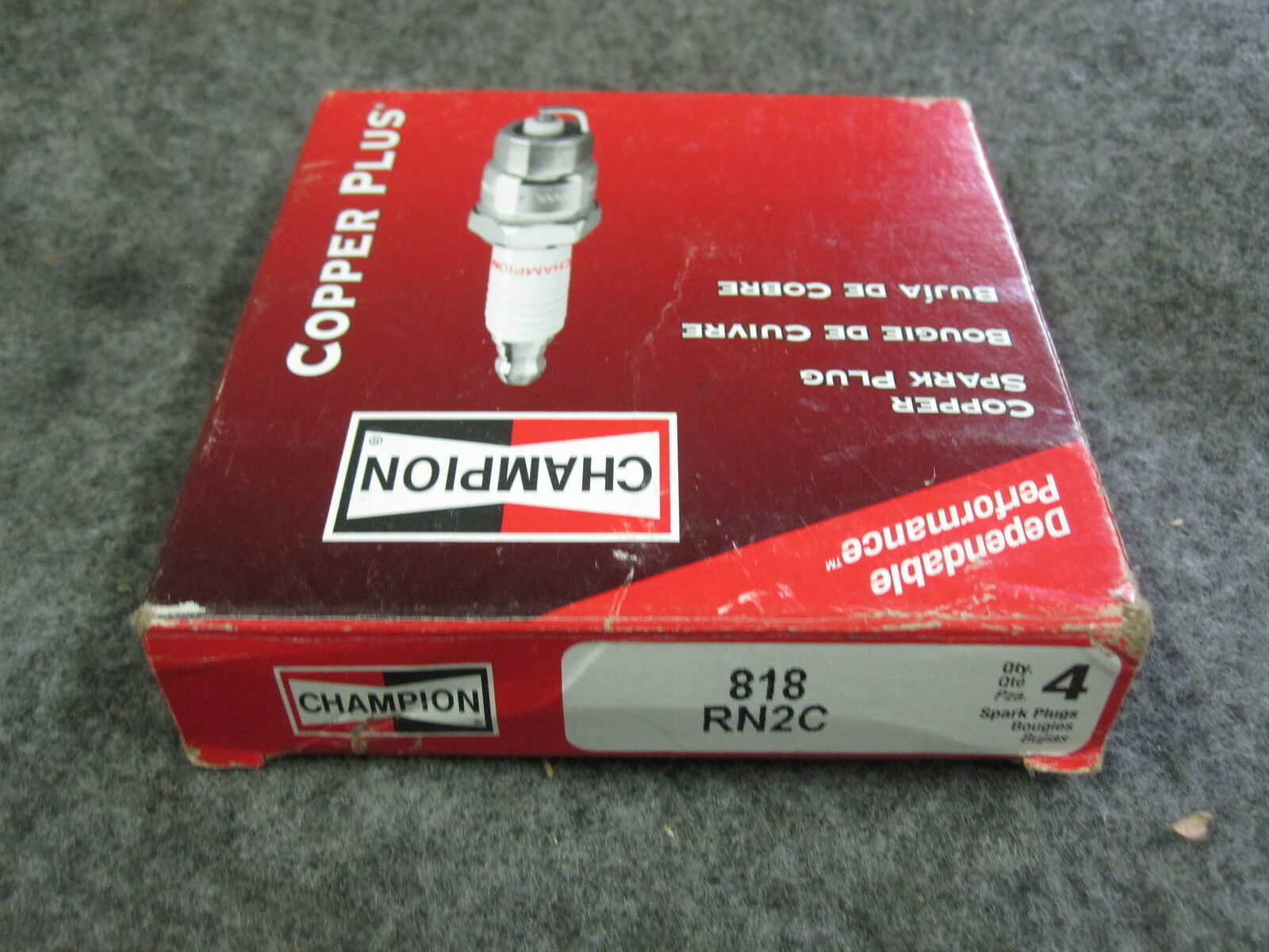 4 CHAMPION SPARK PLUGS RN2C, STOCK # 818