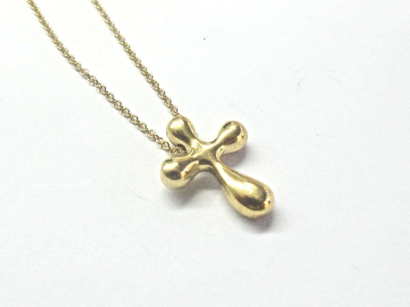1e15d9719 Tiffany & Co 18Kt Elsa Peretti Cross Pendant and 50 similar items. S l1600