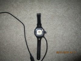 Black Garmin Forerunner 10 with charger - $89.99