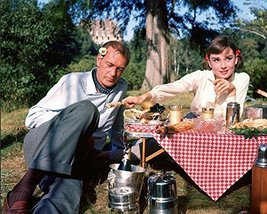 Audrey Hepburn and Gary Cooper in Love in the Afternoon eating picnic on set - $69.99
