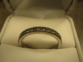 RING has small clear rhinestones all around it on silver color RING size... - $9.89