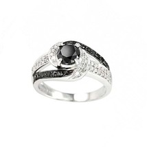 over 40 diamonds and a black 1crt diamond in centre ring