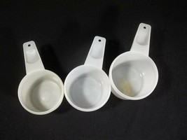 Tupperware Measuring Cups Lot of 3 White 1 Cup 3/4 and 2/3 - $8.86