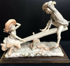 PUCCI Vintage Italian Capodimonte Porcelain See Saw Playing Children Vic... - $94.82