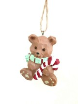 PRE-OWNED PLASTIC TEDDY BEAR CHRISTMAS ORNAMENT ON ROPE, RESEMBLES CARVE... - $6.93