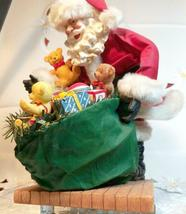"VINTAGE SANTA CLAUS WITH BAG OF TOYS ON HEAVY CERAMIC FLOOR BASE -  10""X10"" image 3"