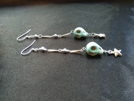 Soothing Blue Howlite Skull Earrings with Dangling Star Charms - $12.95