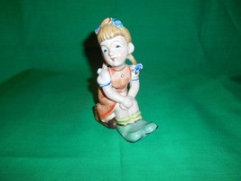 Ucago, Occupied Japan, Figurine of Little Girl Sitting Down on Wooden Box. - $15.99