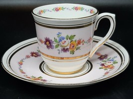 Colcloogh demitasse cup and saucer flowers and gilt on pink and white - $15.00
