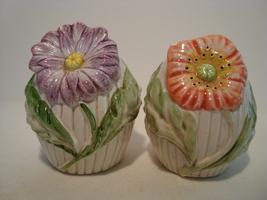 Fitz & Floyd porcelain flower shape off white salt & pepper shaker set. - $10.00