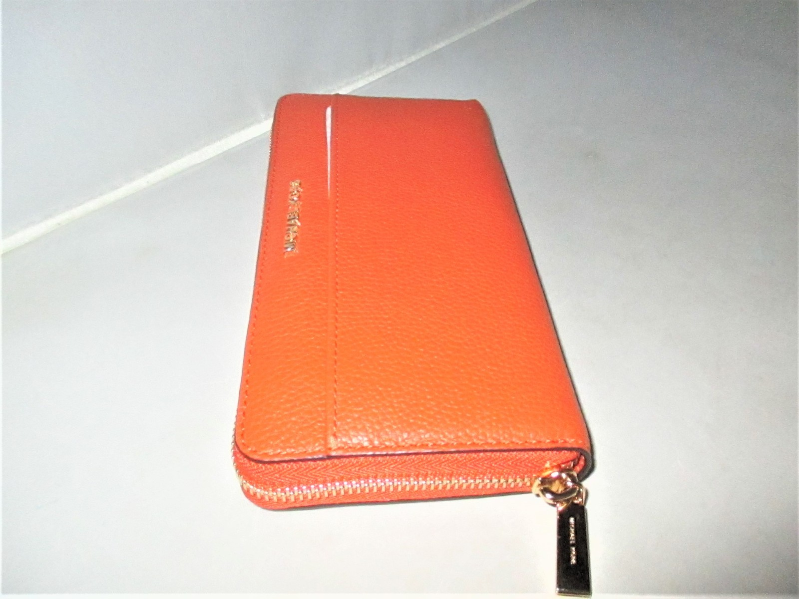 d6ca4f76cee7 Michael Kors Mercer Pebbled Leather Zip-Around Continental Wallet $158  Orange