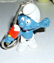 1979 dated Peyo Smurf eating Popsicle Key Chain Brainy Smurf - $9.79