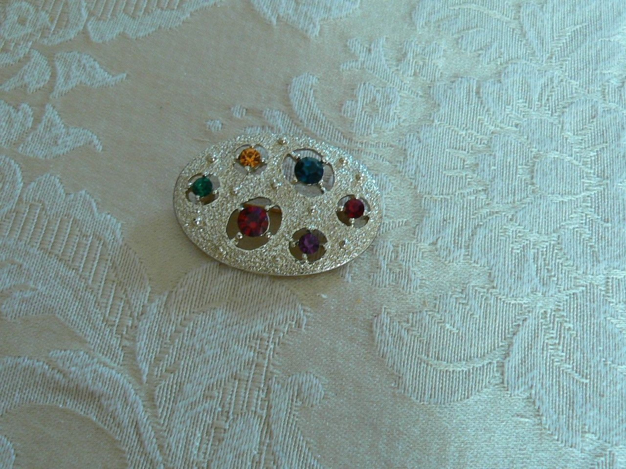 Avon Vintage Brushed Gold Tone Oval Various Colors Rhinestone Brooch