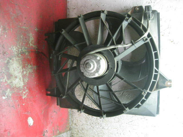 Primary image for 97 98 99 00 01 Hyundai tiburon oem left radiator cooling fan motor & shroud
