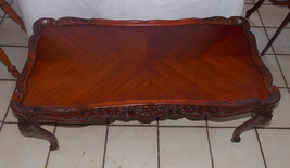 Ribbon Mahogany Book Matched Veneer Top Carved Coffee Table - $499.00