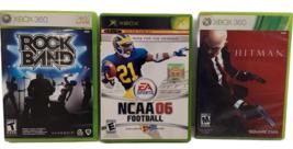 Lot of 3 Microsoft Xbox and Xbox 360 Video Games - Rock Band / Hitman / ... - $9.89