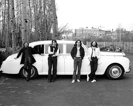 The Beatles in front of a white Rolls Royce 1960's  - $7.18