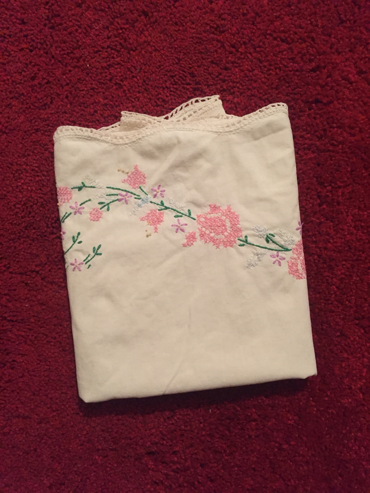 One Antique embroidered floral pillowcase with crocheted edge