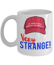 Very Strange! Is This Place Great Or What Funny Trump Saying Coffee Mug - $15.99