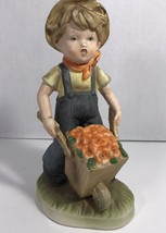 Porcelain Figurine Boy with Flowers in Wheel Barrow Wearing Coveralls - $7.69