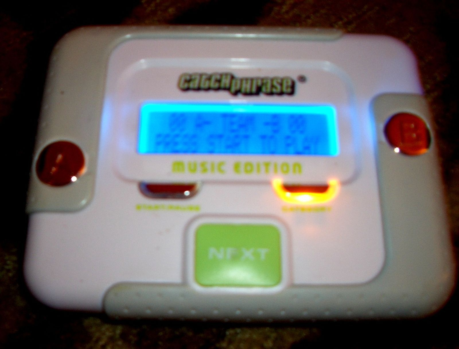 Catch phrase music edition handheld electronic game
