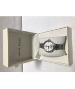 Anne Klein Women's 12/2309SVSV Crystal Accented Silver Tone Mesh Band Watch - $54.09