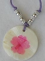 Purple flower on mother of pearl pendant