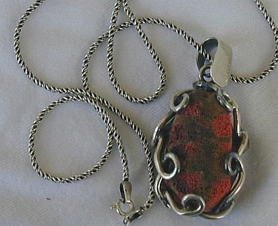 Reddish sea stone pendant