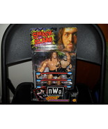 1999  NWO Giant with Rey Mysterio JR. Figure in the Package - $11.99