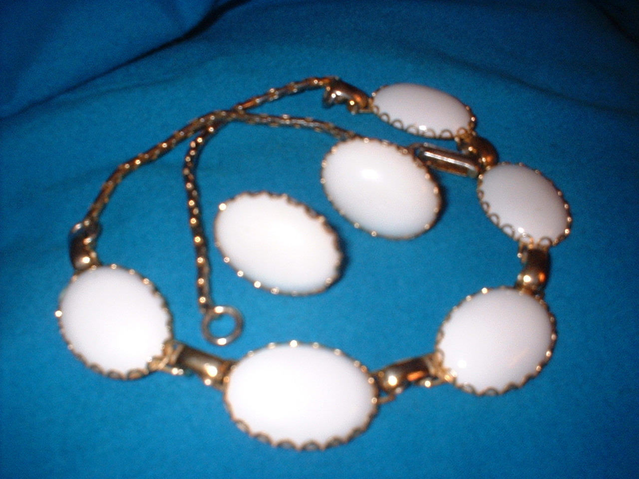 White plastic necklace and earrings set front