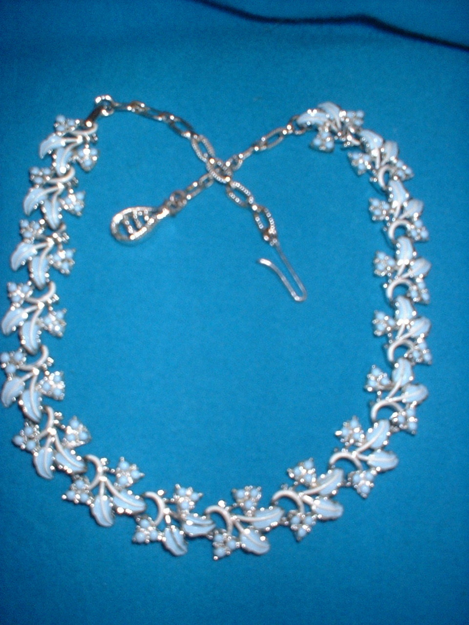 Blue enamel leaf necklace front