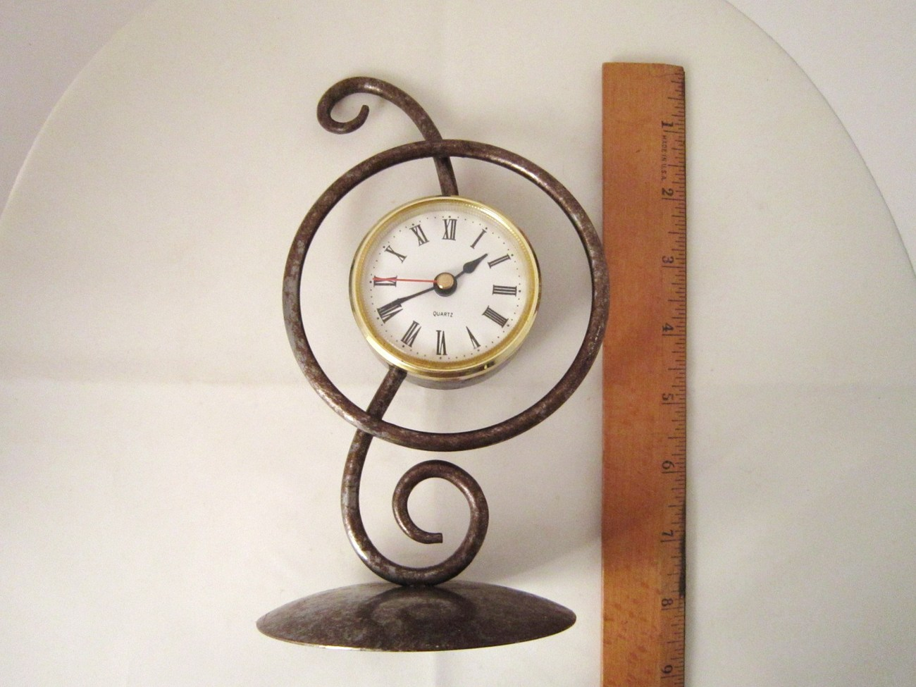 Free Standing Metal Clock with Stylized Treble Clef and Roman Numerals