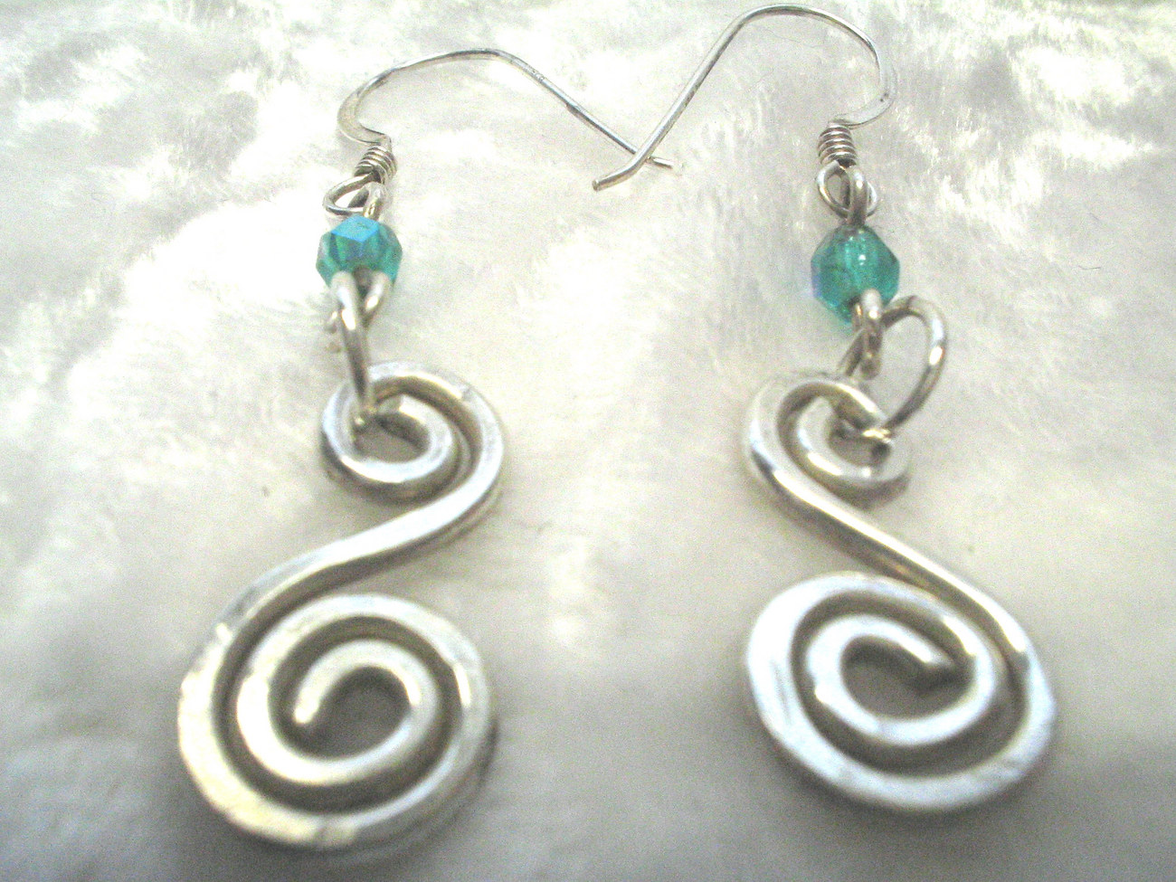 Shanrocks Hammered & swirled SS earrings