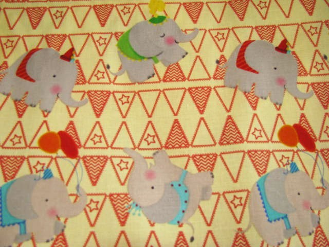 David Textiles  Elephants with Red Flags on Cream Cotton Fabric
