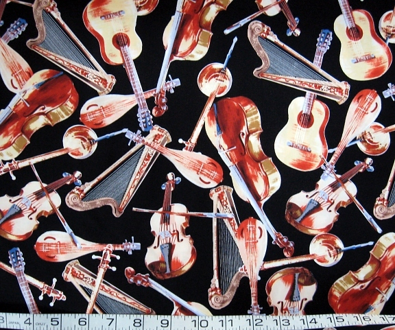 1 yd music/string instruments on black quilt fabric