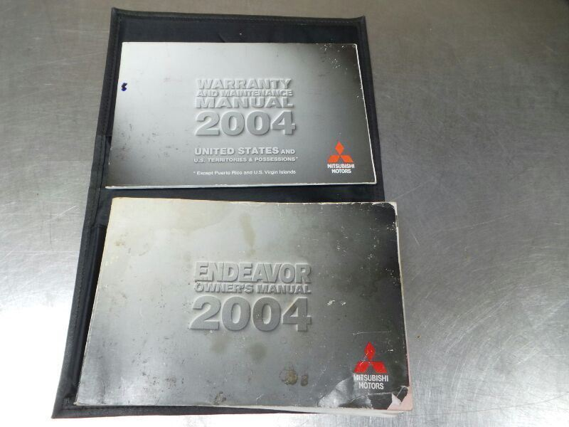 2004 Mitsubishi Endeavor Owner's Manual Set in Case Stained 97642
