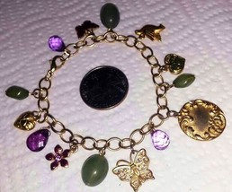 Vintage charm 7.50 inch long bracelet featuring jade beads, enamel charm... - $9.00