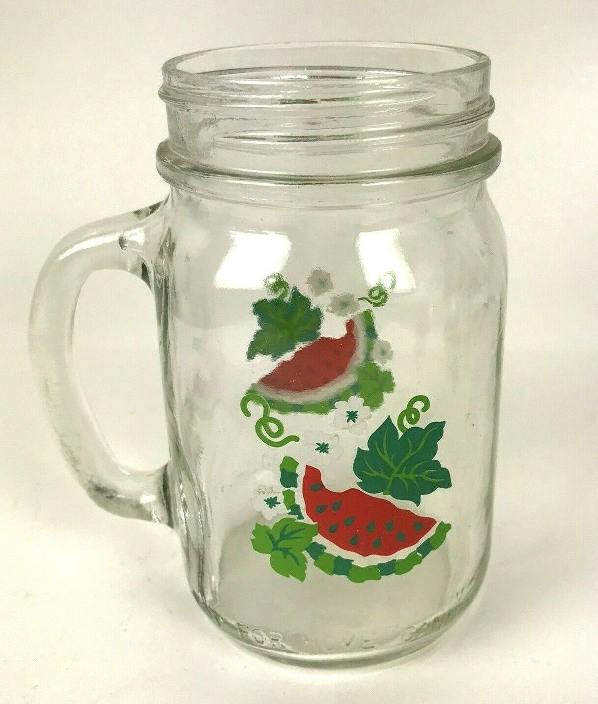 Primary image for Vtg Anchor Hocking Glass Golden Harvest Watermelon 16 oz Mason Jar with handle