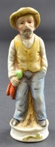"""Man In Hat Leaning On A Log Ceramic Fguine 4.75"""" Tall Collectible - $7.99"""