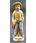 "Man In Hat Leaning On A Log Ceramic Fguine 4.75"" Tall Collectible - $7.99"