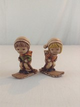 Set Of 2 Vintage Figurines Ceramic Pottery Signed Constable Boy Girl Skiing - $15.88