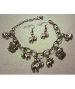 Elephant Charm Bracelet And Earrings In Silver Tone  - $9.99