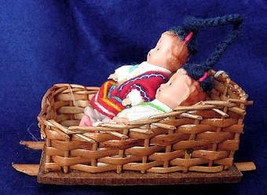 A Pair of Hard Plastic Ethnic Baby Dolls in Wicker Sled - $10.00