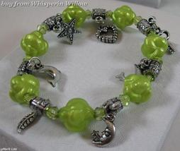 Green Acrylic Stretch Fashion Bracelet with Charms - $7.95