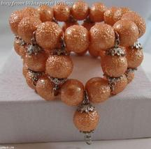 Three Strand Stretch Orange Pearl Fashion Bracelet - $16.00